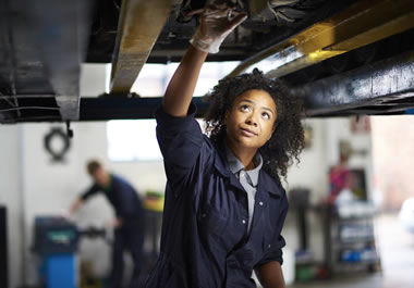 The woman is a mechanic by trade.