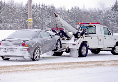 Car being towed to a service station