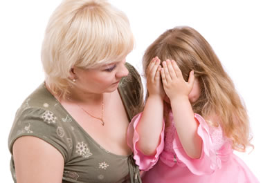 A mother chiding her daughter for bad behavior