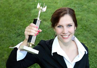 Winner holding up her trophy