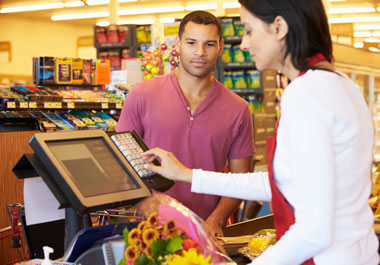 Cashier ringing up purchases in a supermarket
