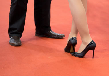 A man and woman wearing dress shoes