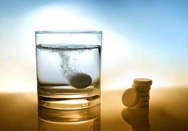 Tablet dissolving in water