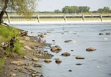 A dam built across a shallow river
