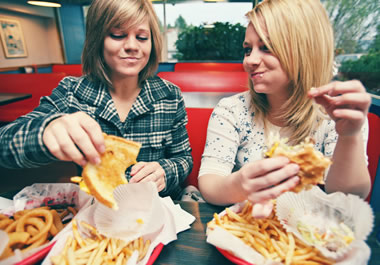 Two friends having lunch at their favorite eatery
