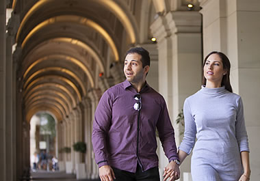 A couple walking through an archway