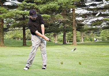 The golfer's shot sent divots through the air.