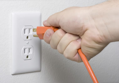 Plugging an electric cord in a wall socket