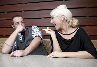 The man finds the woman's smoking repulsive.