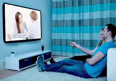 The couple is vegging out in front of the TV.