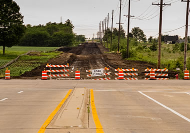 The city barricaded the unfinished part of the road.