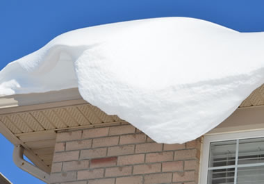 Snow accumulating on a roof
