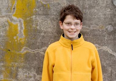 Boy in fleece jacket.