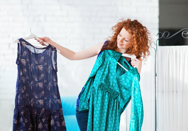 The choice between the two dresses is a toss-up—she likes both.