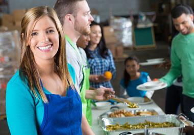 Servers at a soup kitchen