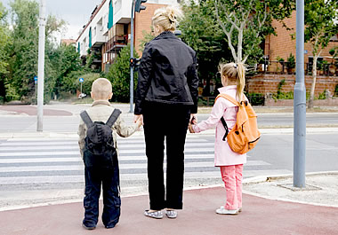 Mother accompanying her children on the way to school