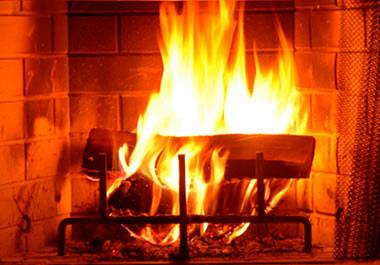 A fire blazing in a fireplace