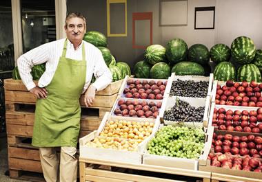 The man sells homegrown fruit.