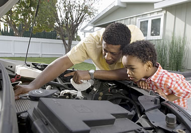 Father and son doing car maintenance together