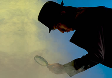 A private investigator holding a magnifying glass