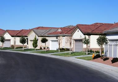 The houses on the street look similar.