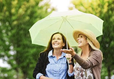 The women had the foresight to bring an umbrella.