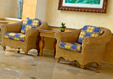 Wicker chairs with seat cushions