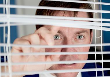 Man snooping on his neighbors