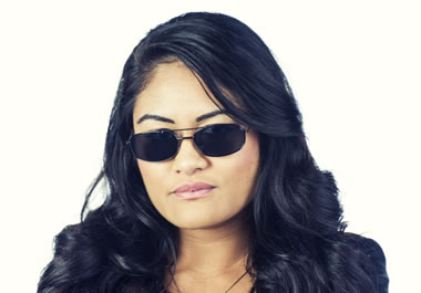 The sunglasses conceal her eyes.
