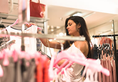 A shopper in a retail clothing store