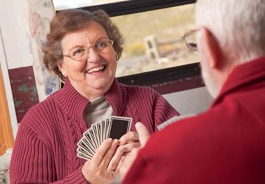 A couple playing a lighthearted game of cards.