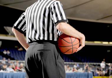 Referee holding the basketball during a pause in the game
