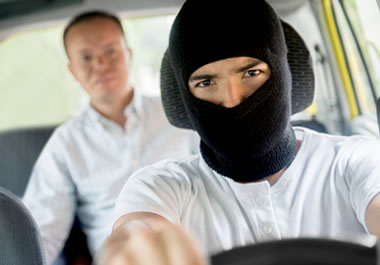 Man being kidnapped by a driver wearing a hood