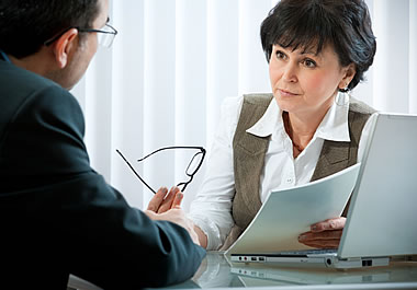 Man seeking investment advice from a consultant