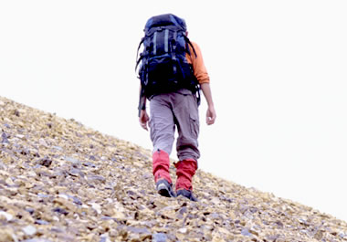 Hiker walking up a steep slope