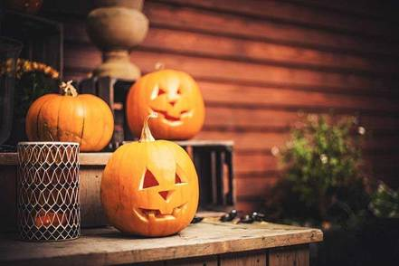 carved-pumpkins-on-porch