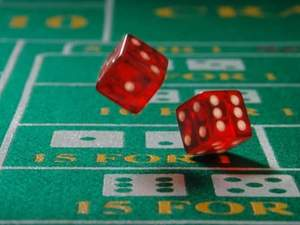 dice being thrown on craps table